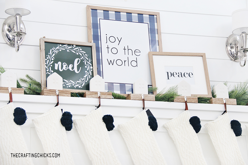 Joy to the World Christmas print on a white mantel.