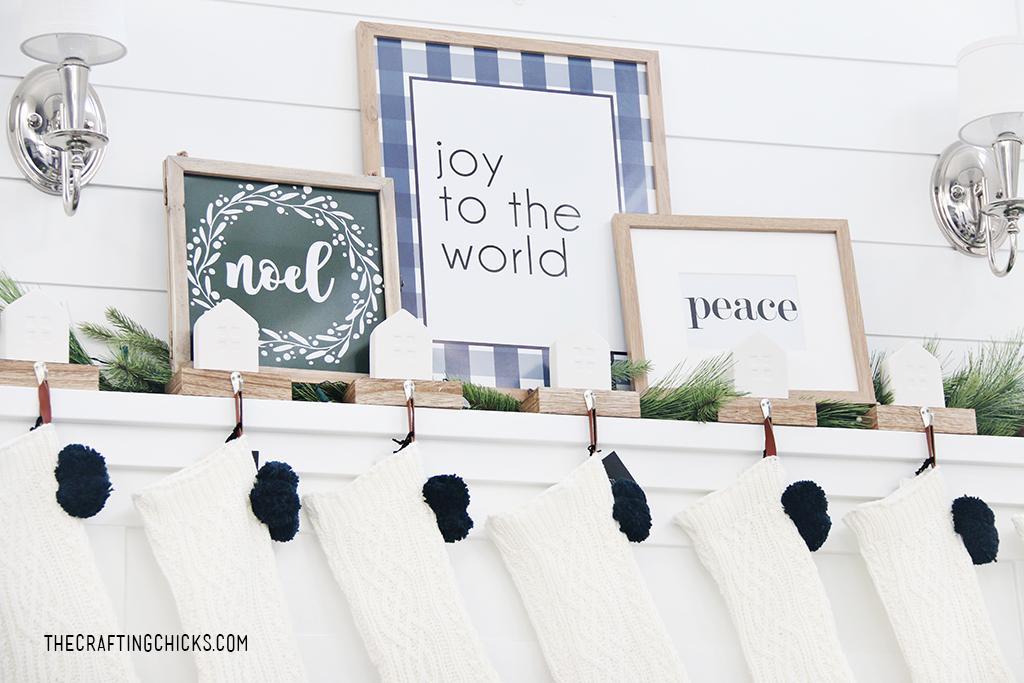 Joy to the World Christmas print on a white mantel.