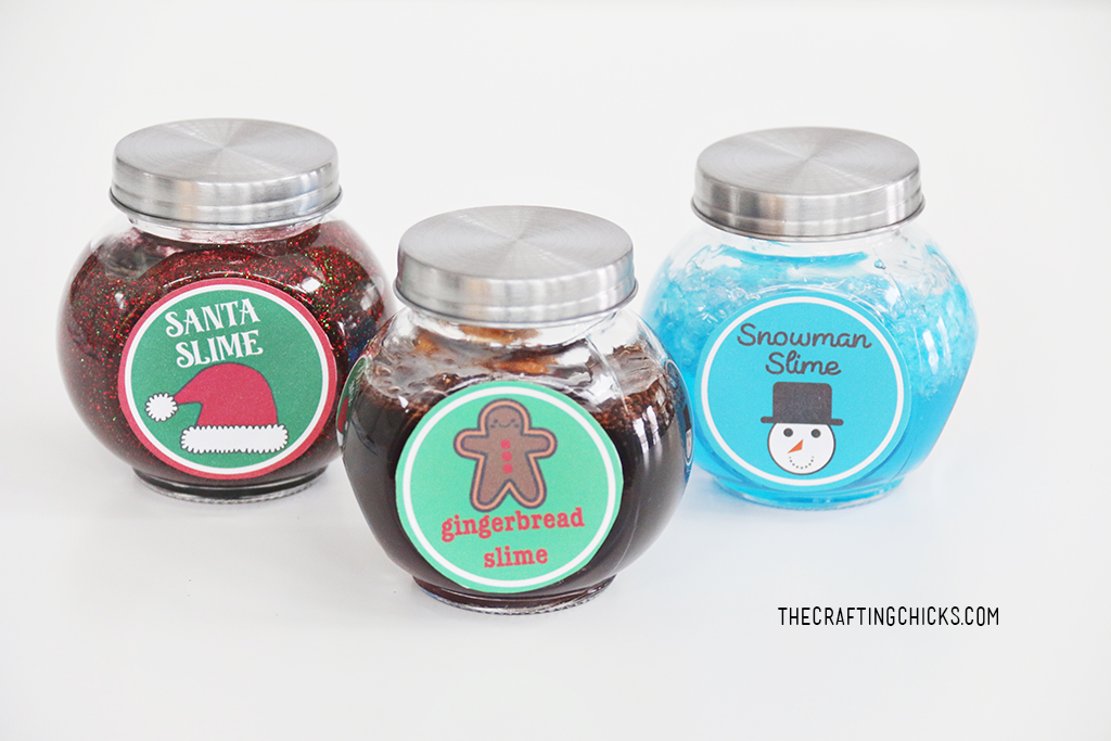 Santa Slime, Gingerbread slime, and Snowman slime in jars with lids on a white background