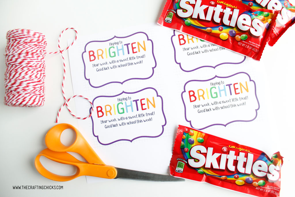Brighten your day printable gift tags printed out with bakers twine, scissors, and skittles