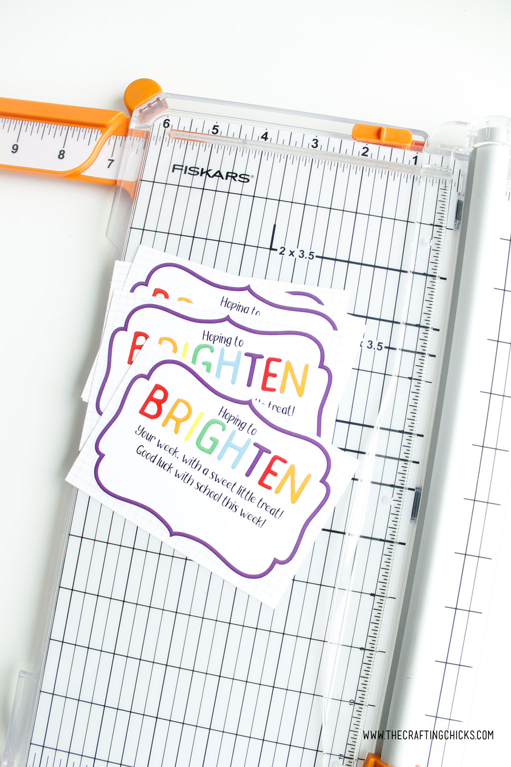 Brighten your day printable gift tags cut into squares using a paper trimmer