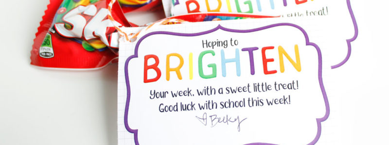 Brighten your day gift tag printable tied onto Skittles candy for a fun gift idea.