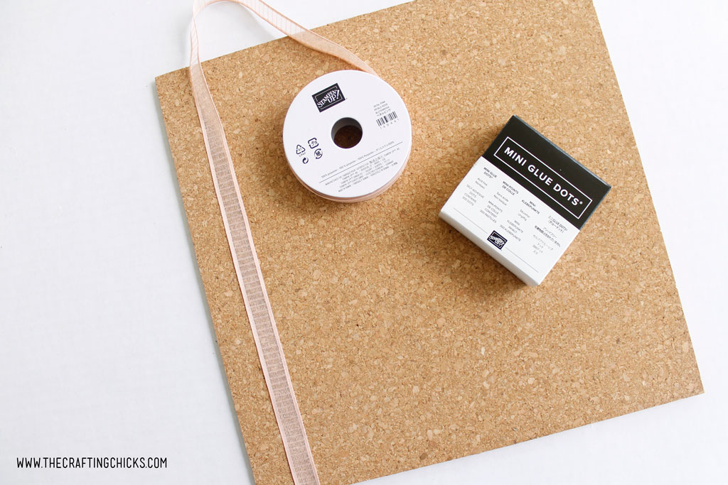 Adding ribbon to a cork board with adhesive glue dots