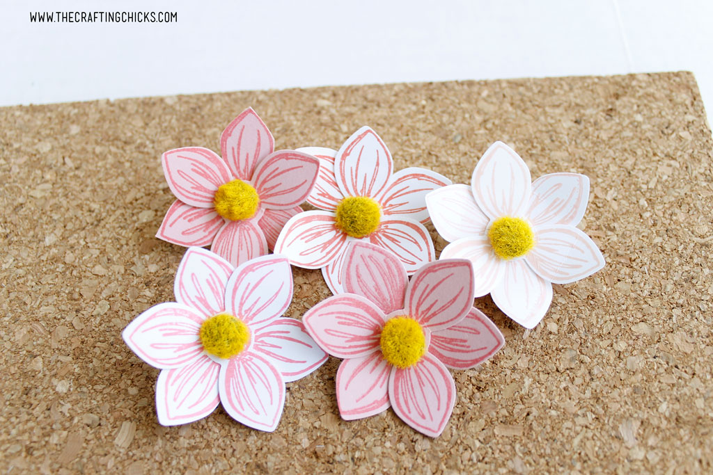 Stamped flowers turned into push pins