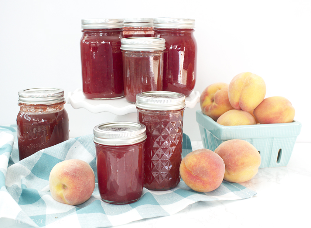 peach and raspberry bottles of jam