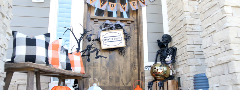 Cute Plaid Halloween Porch with black, white and orange colors.