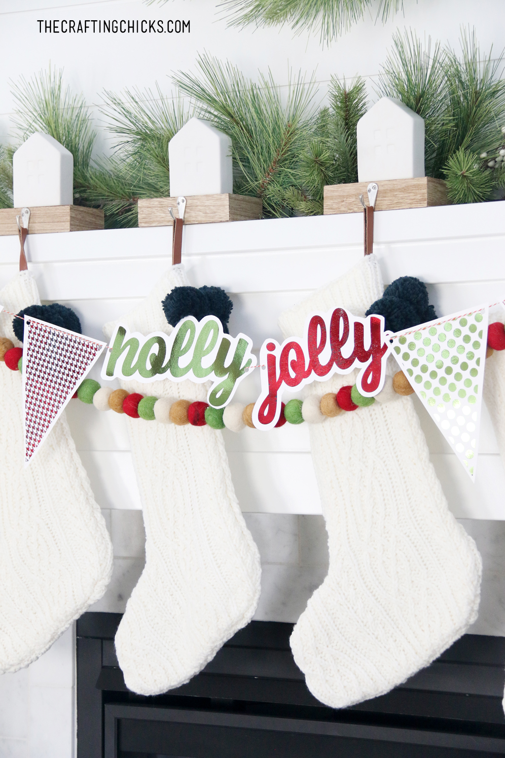 White Stockings on a mantle with adorable foiled Holly Jolly banner