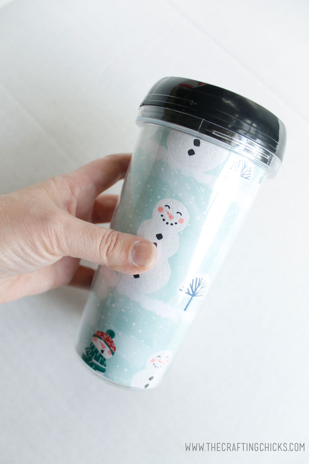 Place holiday paper inside DIY Mug for gift idea