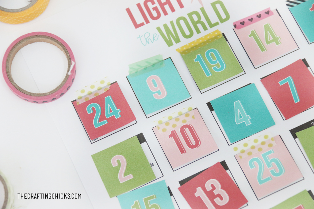 Attach the number squares for the Light the World Advent using washi tape or glue.