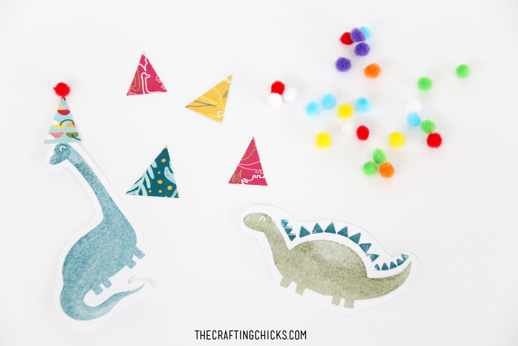Hand stamped Dinosaurs for Cute Dinosaur Cupcake toppers.