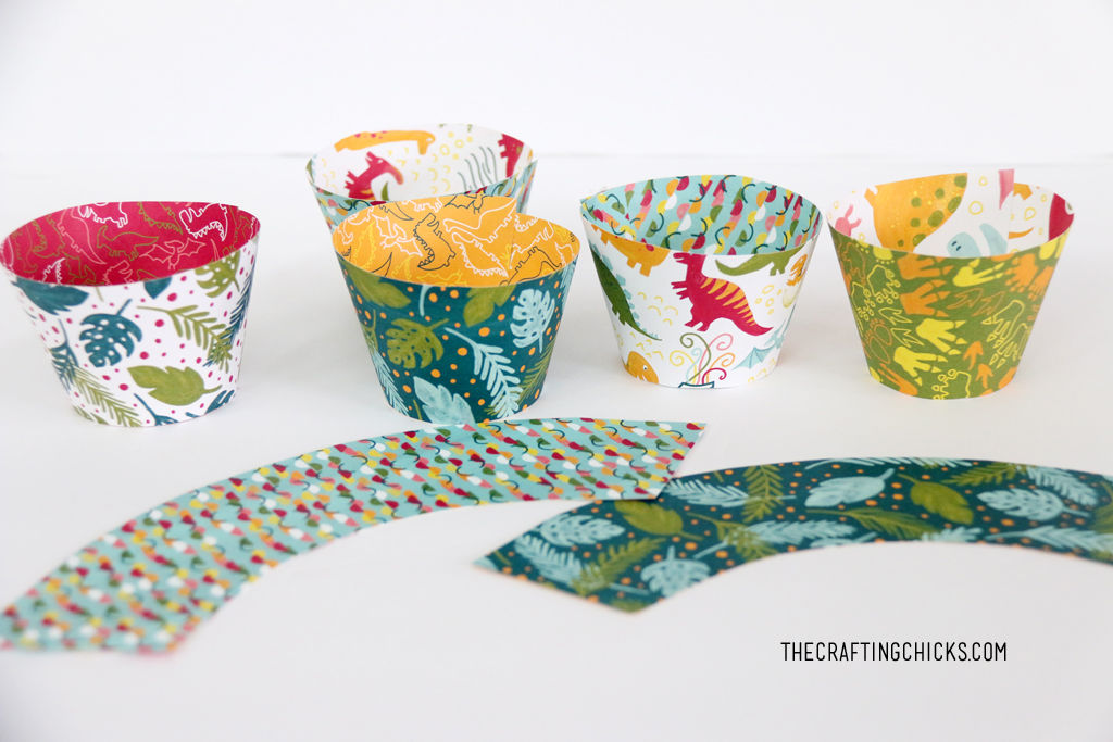DIY Cupcake wrappers made with dinosaur scrapbook paper.
