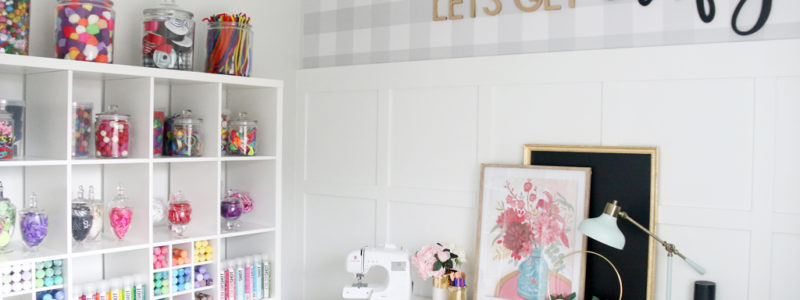 Craft Room Design with white shelves decorated with colorful crafting supplies.