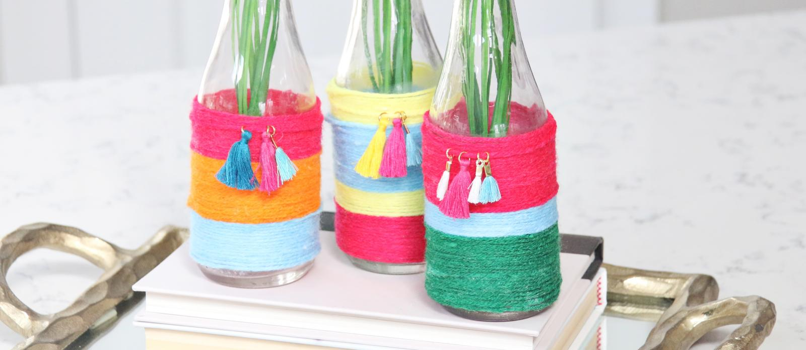 colorful yarn wrapped jars