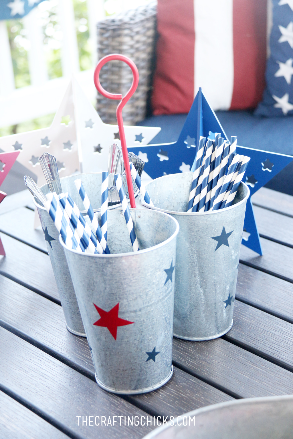 Metal Galvanized utensil holder with red and blue stars.