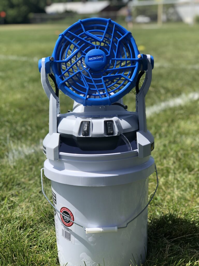 Blue fan on top of a 5 gallon bucket for sports games
