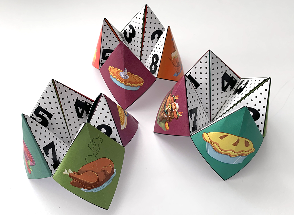 folded Thanksgiving Cootie Catchers on white background