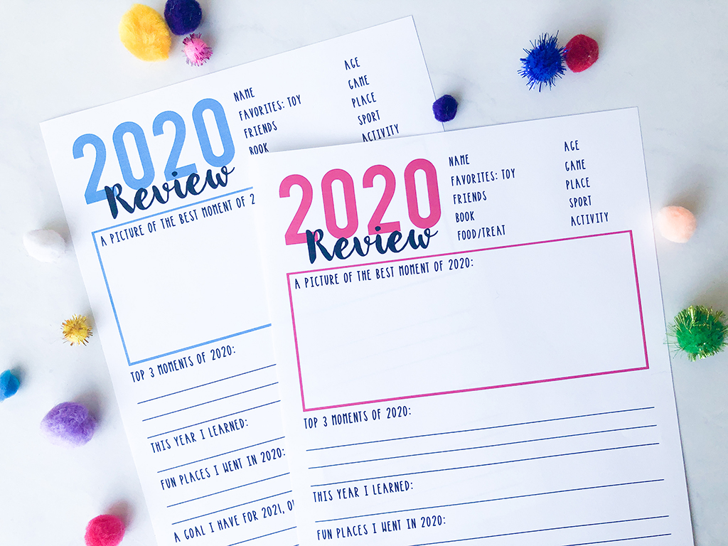 Year in review printables for kids and family on white background and blue and pink typing