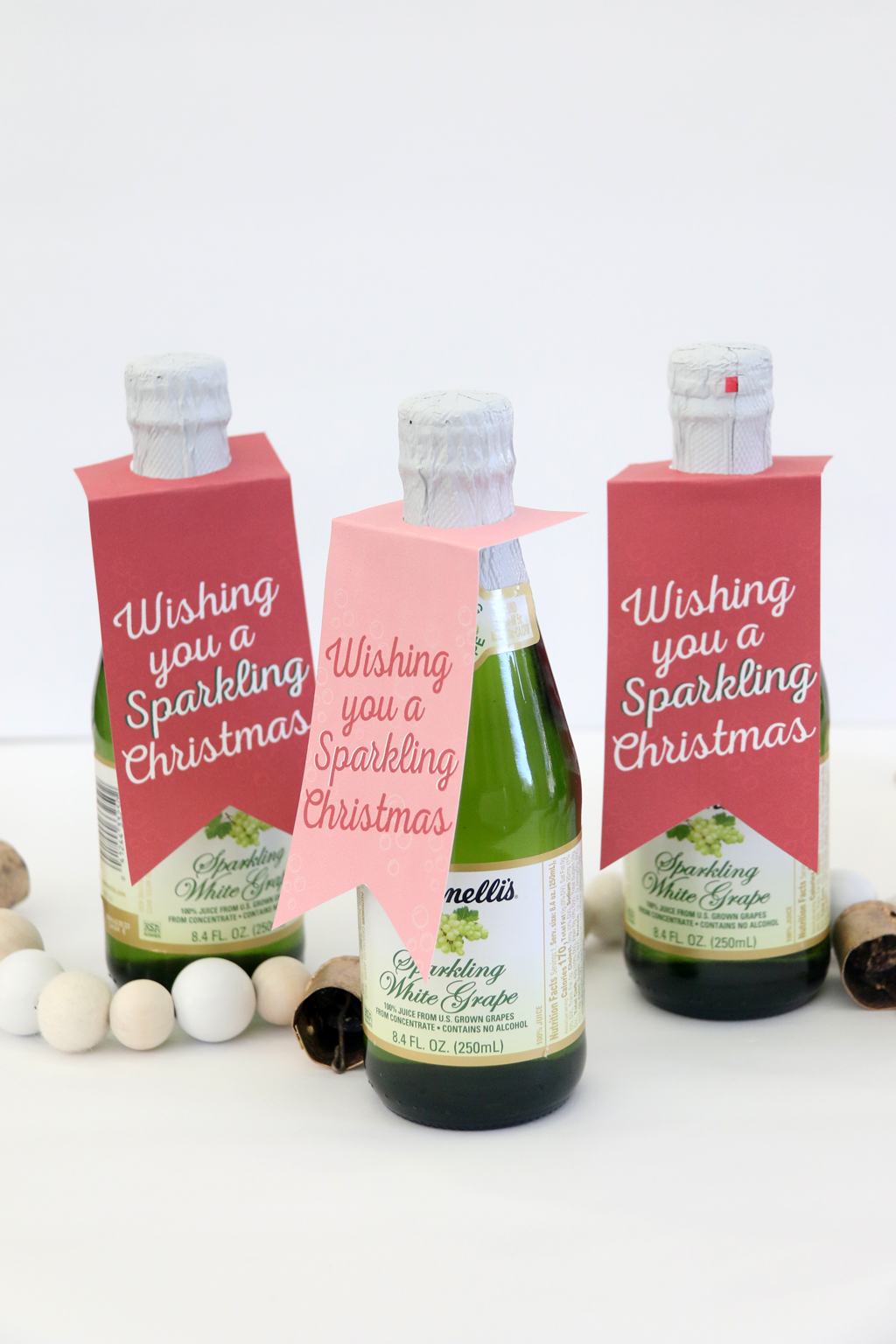 Wishing you a Sparkling Christmas printable tag on a bottle of sparkling cider.