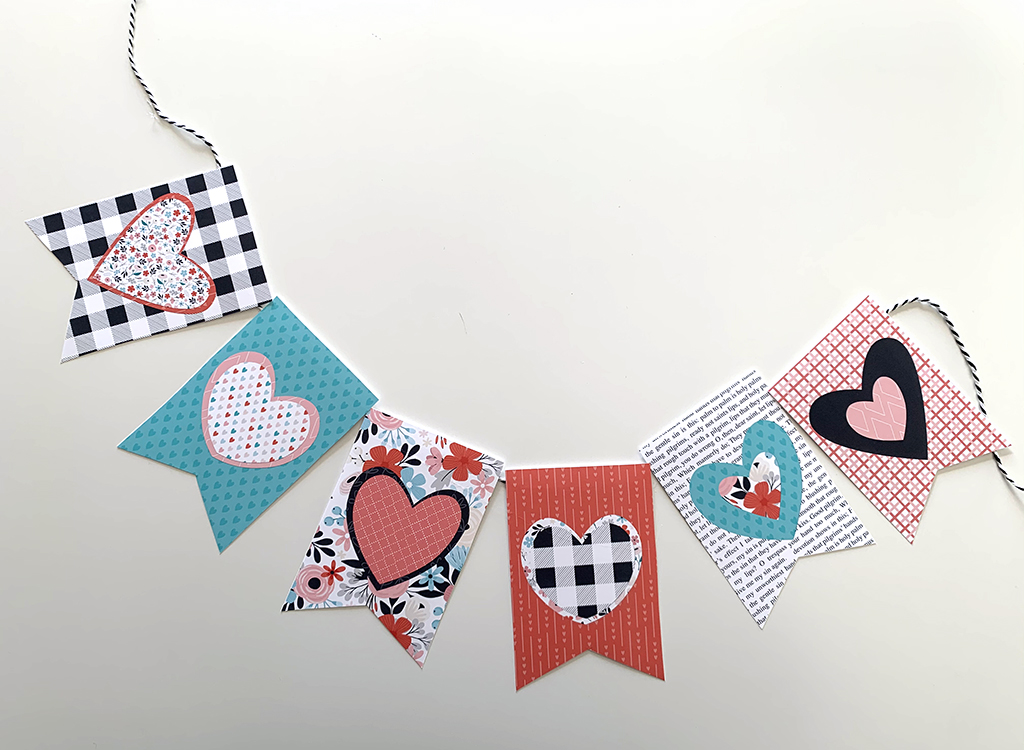 Valentine Banner in black, white, read, pink, and teal with hearts on a white background