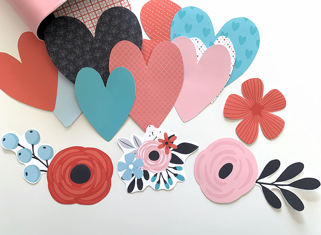 Valentine printable hearts and flowers in pink, red, white, black and teal on a white background