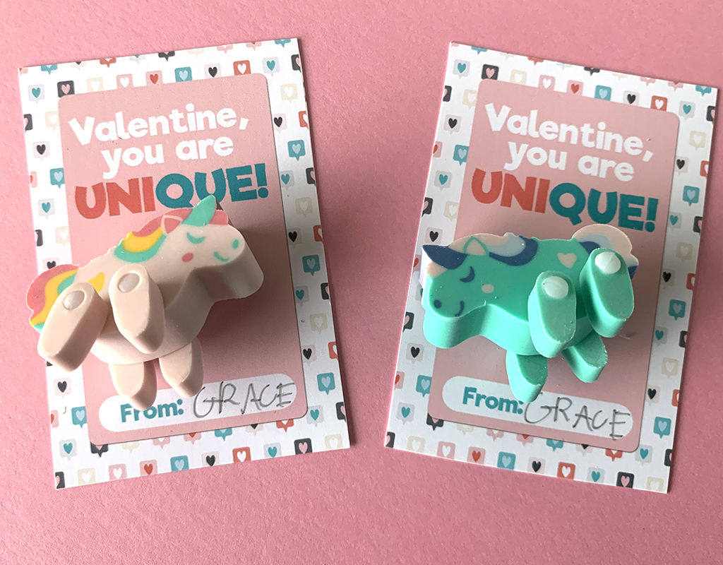 Pink and green unicorn erasers on Free Unicorn Printable Valentines on pink background